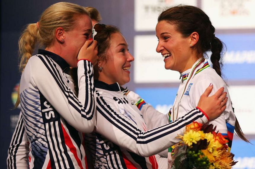 Elizabeth Armitstead of Great Britain celebrates with team mates Jessie Walker (left) and Lucy Garner (centre) for the Elite Women's Road Race on day seven of the UCI Road World Championships on September 26, 2015 in Richmond, Virginia.