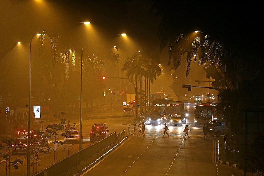 The hazy streets near AMK Hub in Ang Mo Kio last Thursday night. There were as many as 170 tweets a minute at about 9:30pm last Thursday, when the authorities announced that primary and secondary schools would be closed the next day. The three-hour P