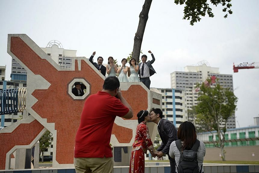 With the haze clearing up to healthier levels yesterday afternoon, newlyweds Mr Han Yap and Ms Ng Mei Fen, both 29, were able to go ahead with their outdoor photo session at a playground in Toa Payoh Lorong 6.