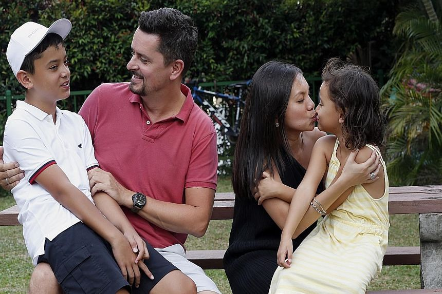 Mr and Mrs Oliver Plogmann stopped kissing their 12-year-old son, Noah (left), on the lips when he was four. Mrs Plogmann- Koh still kisses daughter Noemi, six, on the lips. Mr Shivakumar Deshinamorthy and his wife Kanniakumari Kulasekaralagoo with t