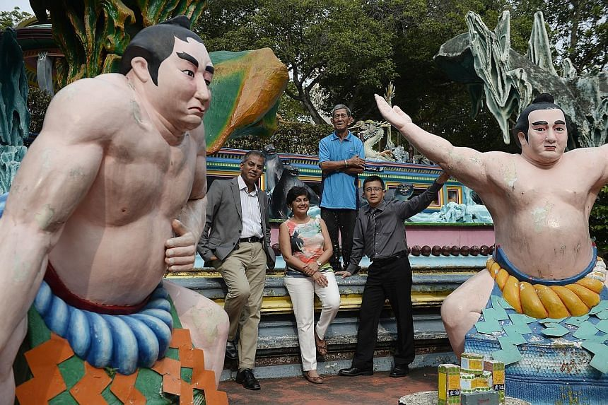 Tour operator Journeys' chairman of the board of directors Jeya Ayadurai (left) at Haw Par Villa with colleagues Savita Kasyhap and Chan Ying Loone, and park artisan Teo Veoh Seng (rear). The park's quirky statues and gruesome depiction of the underw