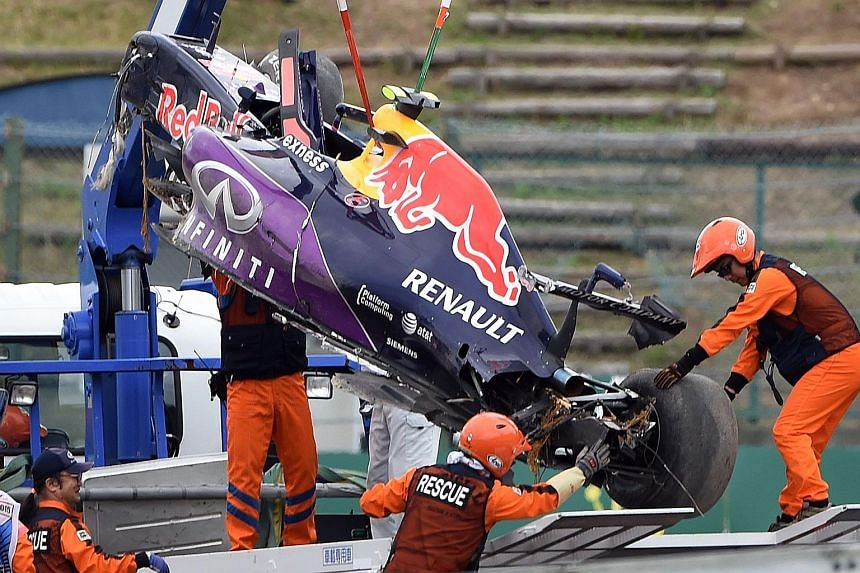 The Red Bull of Daniil Kvyat being hoisted onto a truck after his crash in qualifying at Suzuka. Lewis Hamilton will hope for a repeat of last year, when he beat pole-sitter and Mercedes team-mate Nico Rosberg to win the race.