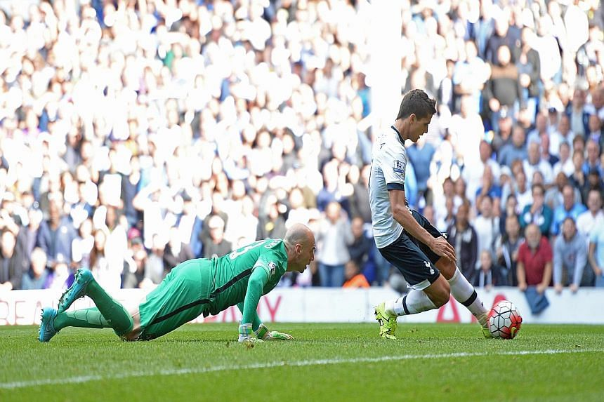 Erik Lamela scoring Tottenham's fourth goal in the 79th minute to complete the rout with City goalkeeper Willy Caballero well beaten. The visitors had taken an early lead.