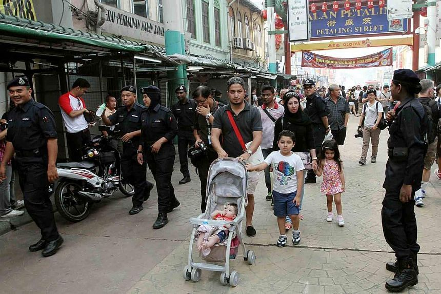 It was business as usual in Petaling Street yesterday, with a strong police presence adding to the congestion.