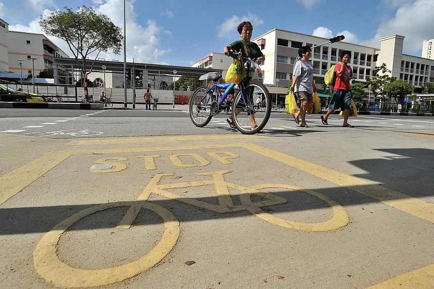 Until the rest of the country has cycling lanes like in Tampines (left), both cyclists and pedestrians must learn to share roads and pavements with mindfulness and graciousness.