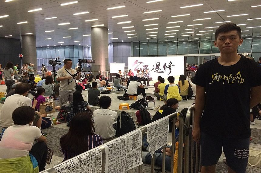 """Yesterday's seminar to mark the anniversary of the Sept 26 student protest that catalysed the Occupy movement attracted fewer than 50 people. Student Wong Yiu Cho (at right) said his classmates have """"forgotten what we went through""""."""