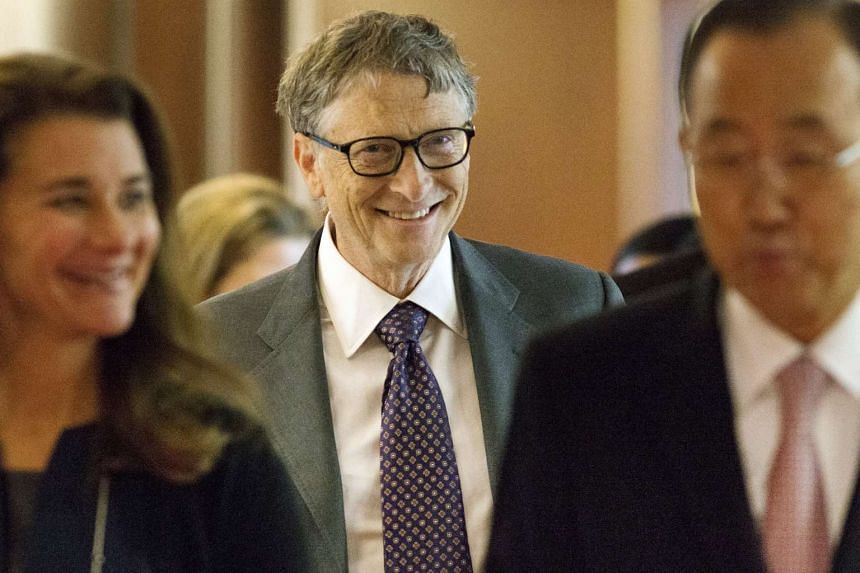 Bill Gates (centre) walks to a meeting with his wife Melinda Gates and UN Secretary-General Ban Ki-moon during the United Nations General Assembly.