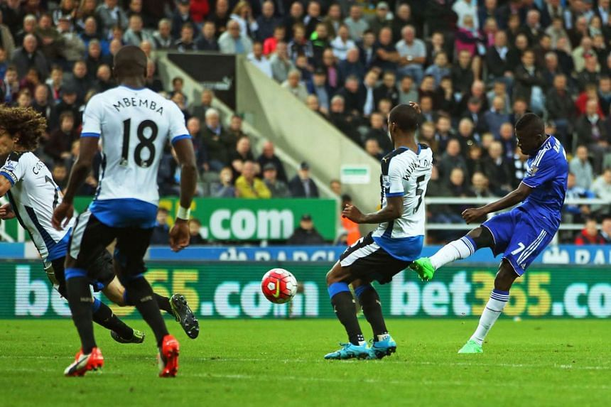 Chelsea's Brazilian midfielder Ramires (right) shoots to score their first goal.