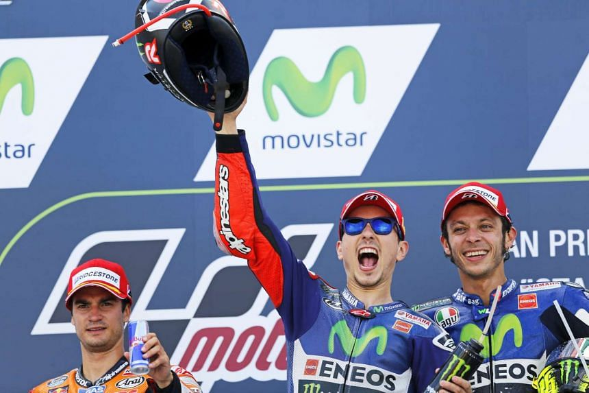 Jorge Lorenzo (centre) celebrates his win with second-placed Dani Pedrosa (left) and third-placed Valentino Rossi after winning the Aragon Motorcycling Grand Prix in Alcaniz, northern Spain, on Sept 27, 2015.
