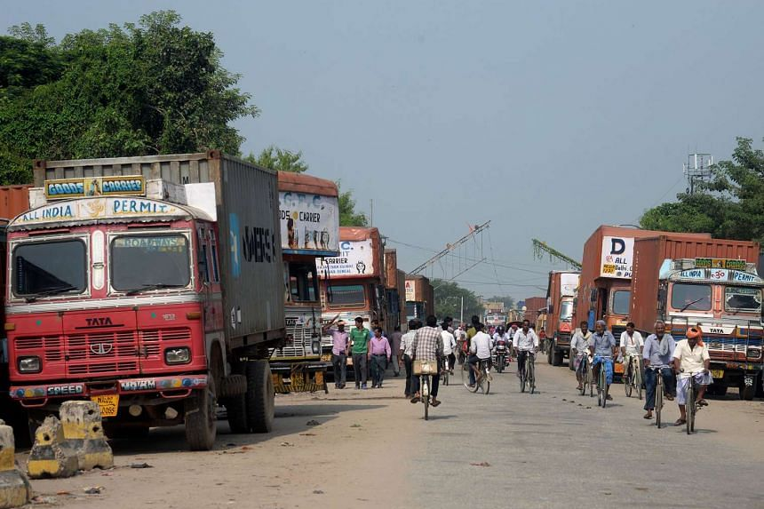 Nepalese and Indian trucks park near the Nepal-India border at Birgunj some 90km south of Kathmandu on Sept 26, 2015.