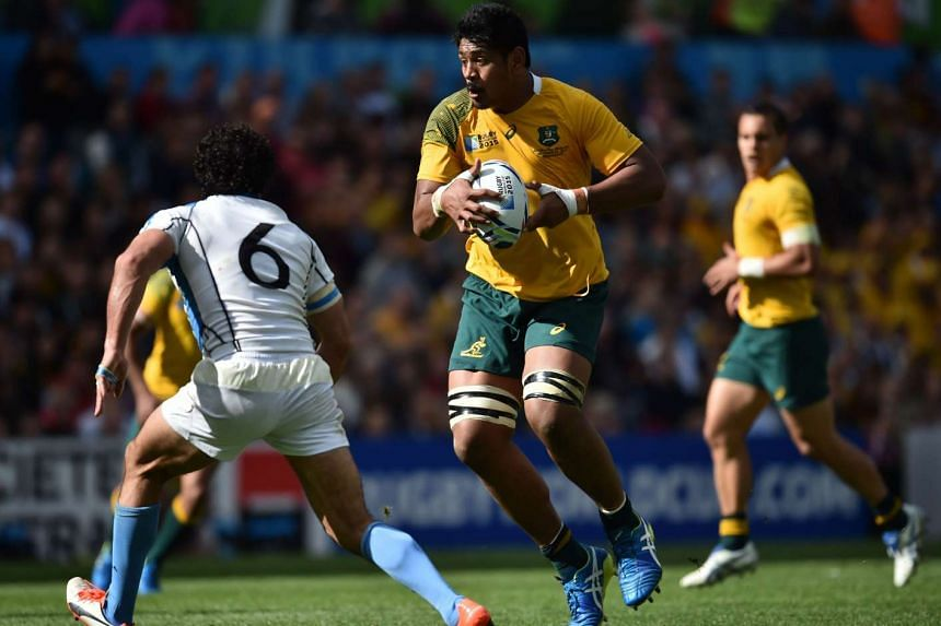 Australia's lock Will Skelton (centre) runs with the ball during the Rugby World Cup match with Uruguay on Sept 27, 2015.
