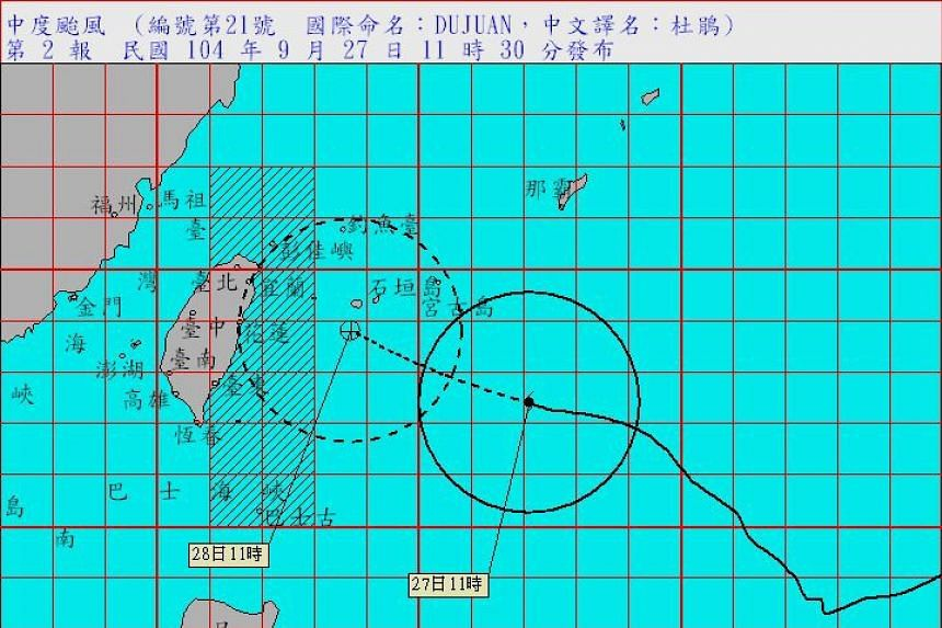 An image from the Central Weather Bureau shows Typhoon Dujuan approach Taiwan's east coast from the Pacific Ocean on Sept 27, 2015.
