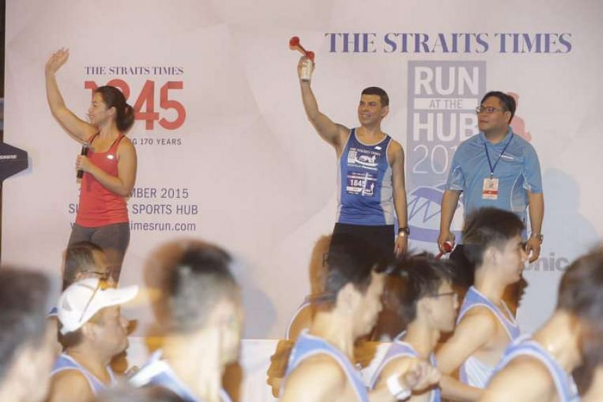 ST editor Warren Fernandez flagging off the 18.45km race of the The Straits Times Run at the Hub.