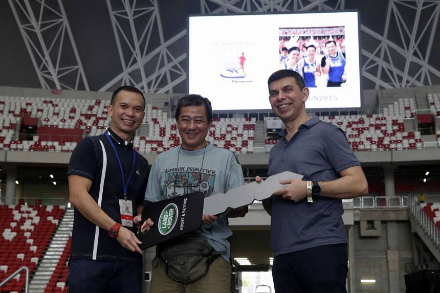 Mike Lee (centre) with ST editor Warren Fernandez (right) and Dennis Lim, sales assistant general manager from Wearnes Automotive.