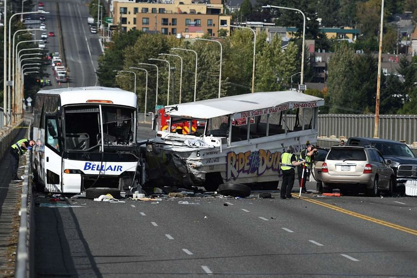 Officers investigating the scene of the crash between a tour bus and a tourist duck boat on the Aurora Bridge in Seattle, Washington on Sept 24, 2015.