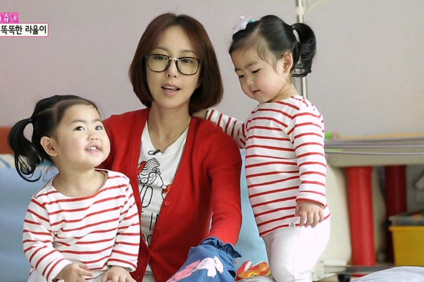 NOW: Shoo from S.E.S. and her twin daughters Ra Hee and Ra Yool on the parenting reality show Oh! My Baby.