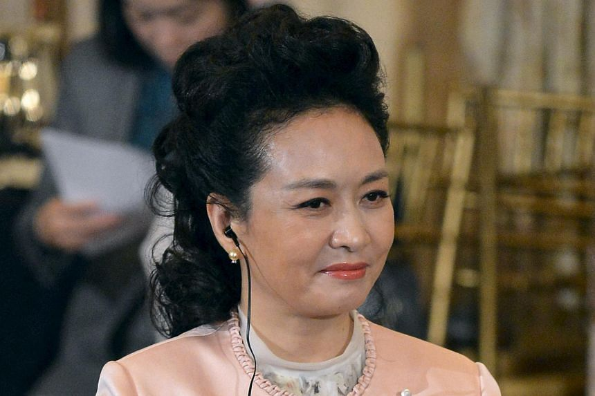 Chinese First Lady Peng Liyuan listens to remarks delivered during a luncheon at the State Department, in Washington, on Sept 25, 2015.