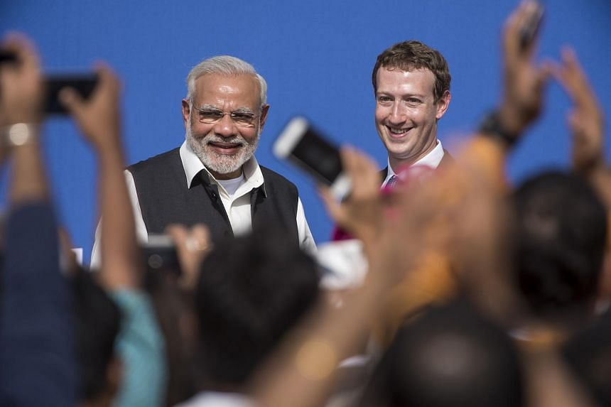 India PM Narendra Modi (left) and Facebook CEO Mark Zuckerberg at a town hall meeting at Facebook's headquarters in Menlo Park, California.