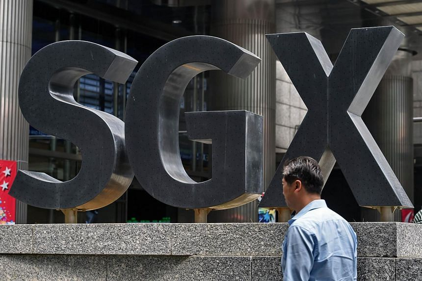 A man walks in front of the Singapore Exchange building at the financial district in Singapore on Aug 25, 2015.