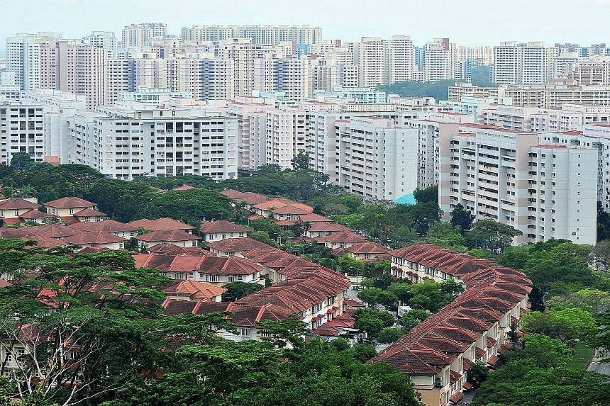 Aerial view of private residences and HDB flats near Tree House condominium on Aug 13, 2014.