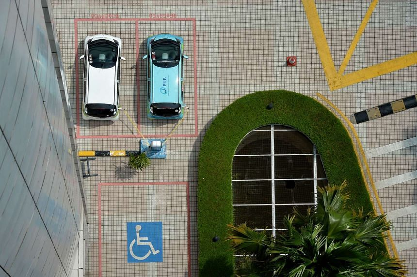 Aerial view of the parking lots, including one for the disabled, at a car park.