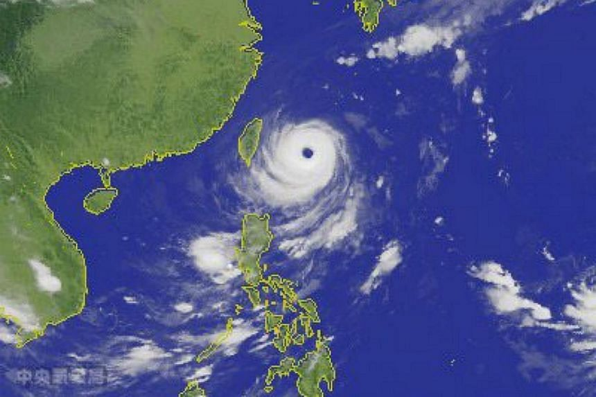 A satellite image made available by the Central Weather Bureau shows Typhoon Dujuan approaching Taiwan's east coast from the Pacific Ocean on Sept 27, 2015.