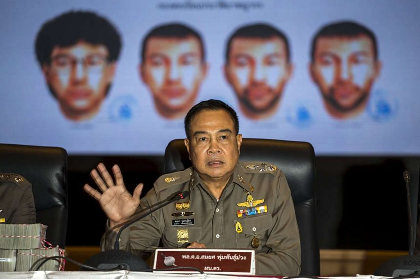 Thai national police chief Somyot Pumpanmuang gesturing during a news conference about the Bangkok blast which killed 20 people, including foreigners, as a screen shows the different looks of a suspect, who has been referred to both as Bilal Mohammed