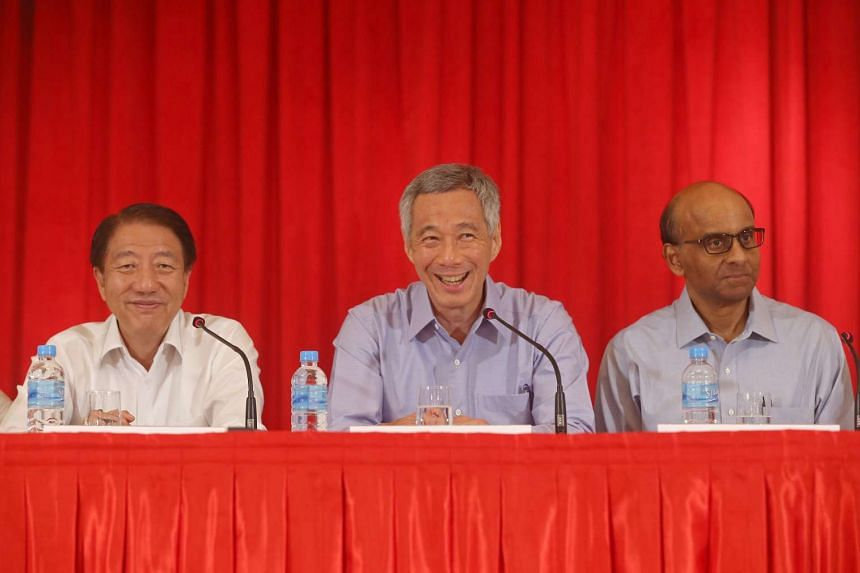 Prime Minister Lee Hsien Loong (centre) announcing the changes at a press conference at the Istana.