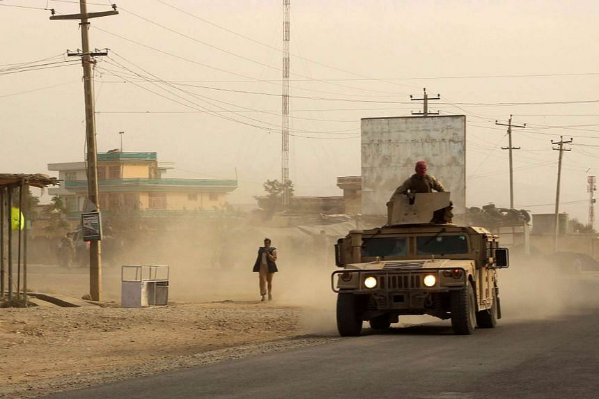Afghan security forces travelling in a Humvee vehicle, as battles were ongoing between Taleban militants and Afghan security forces, in Kunduz, capital of northeastern Kunduz province on Sept 28, 2015. The Taleban are in control of around half of Kun