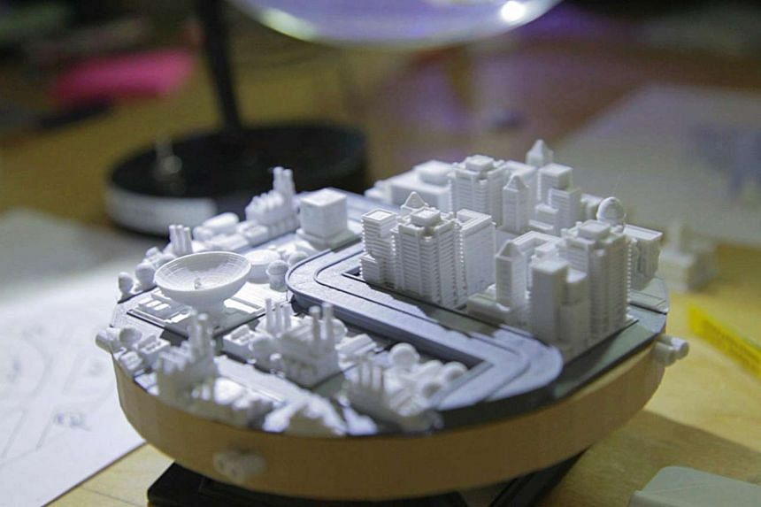 A micro city created by a 3-D printer in Print the Legend, an award-winning documentary on the race for market leadership in 3D printing. 3D printing enables the prototypes for parts to be produced in a matter of days, reducing costs and increasing