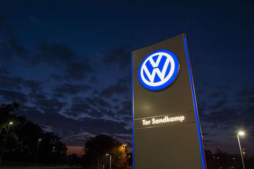 A logo of German car manufacturing giant Volkswagen seen outside its headquarters in Wolfsburg on Sept 25, 2015.