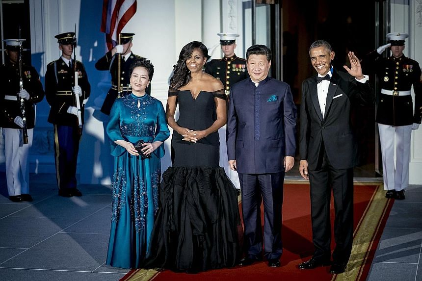 At a White House dinner held in honour of her husband, Ms Peng's (above left) teal-blue gown, matching the colour of Mr Xi's pocket square, features detailed embroidery. Lest you call her too conservative, she shows a bit of skin with cropped sleeves and
