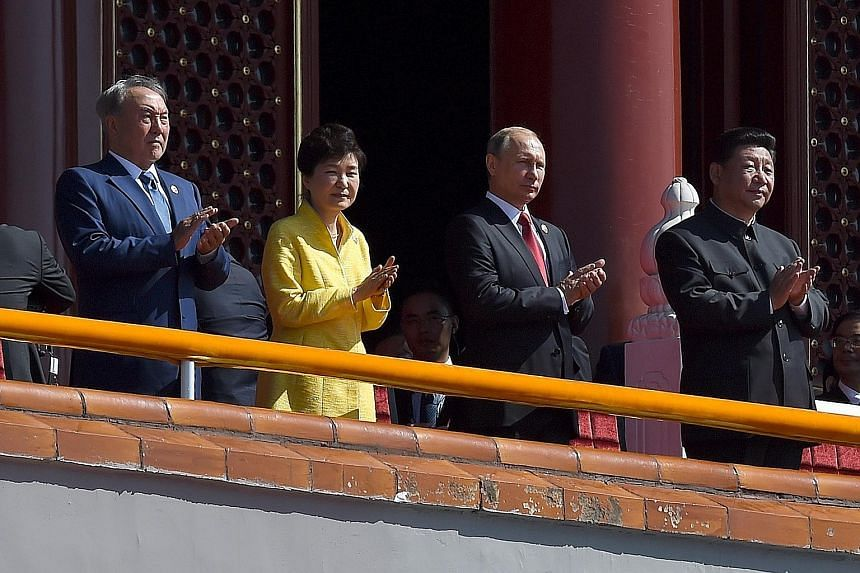 At China's military parade on Sept 3 were (from left) Kazakhstan President Nursultan Nazarbayev, South Korean President Park Geun Hye, Russian President Vladimir Putin and Chinese President Xi Jinping.