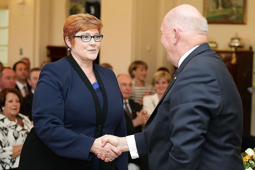 """Ms Marise Payne being congratulated by Australian Governor-General Peter Cosgrove after she was sworn in as the country's first female defence minister in Canberra last Monday. At her first press conference as minister, she asked to be judged """"on my"""