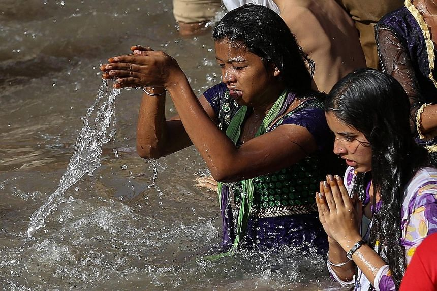 Devotees taking a holy dip in the Godavari River during a Hindu festival last week. While the Modi government feels the interlinking of rivers programme is essential for India's water and food security, environmentalists say the project would affect