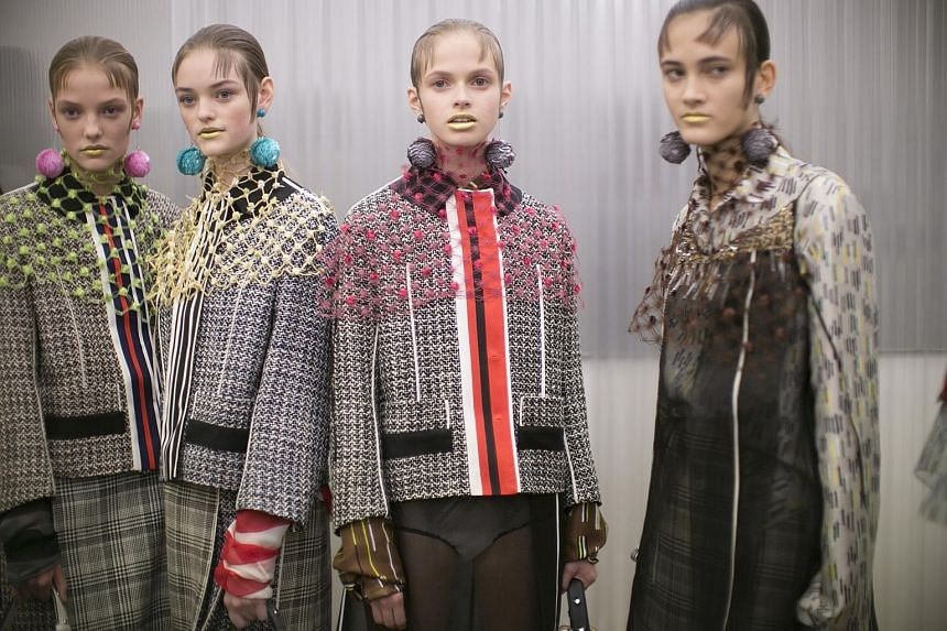 Tweeds, wools and plaids turned up in Prada's version of the skirt suit.