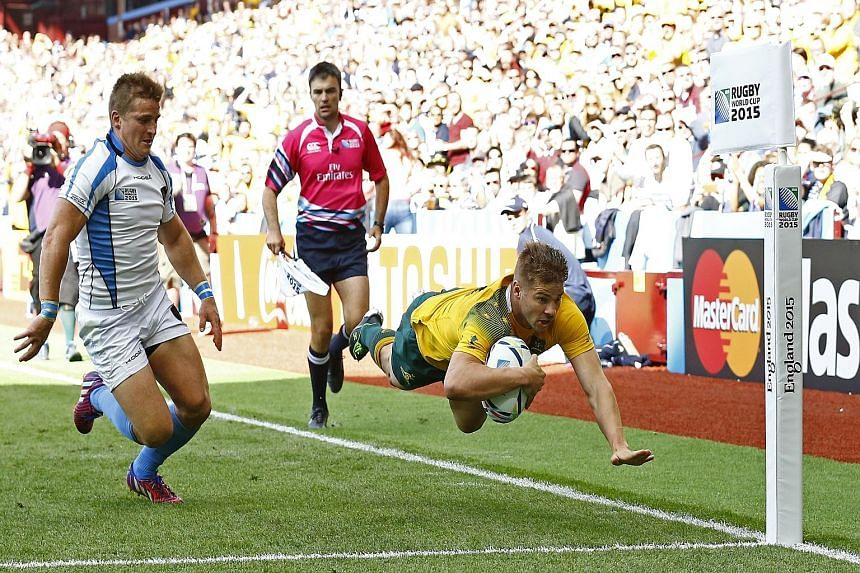 Drew Mitchell scoring his second try and Australia's seventh. A likely full-strength side will tackle fellow giants England and Wales.