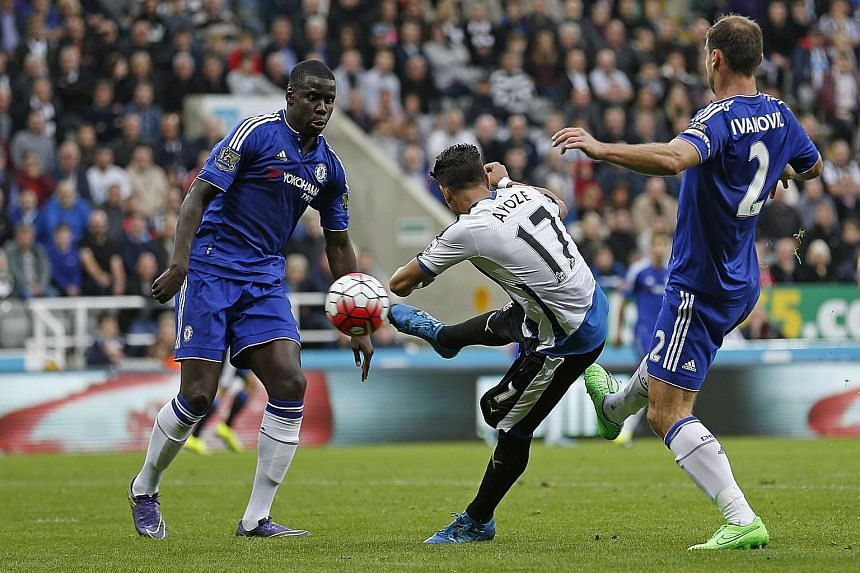 A sumptuous volley by Ayoze Perez (centre) gave Newcastle a surprise lead against Chelsea, who found a second wind later to earn a 2-2 draw.