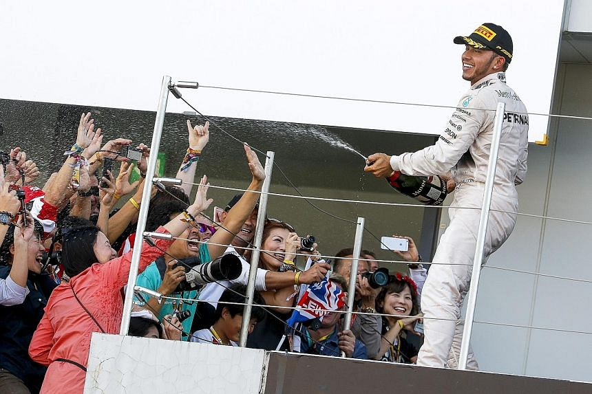 Lewis Hamilton's success at Suzuka puts him in a bubbly mood, given that he now enjoys a 48-point advantage over team-mate Nico Rosberg in the chase for the drivers' title, with five races left.