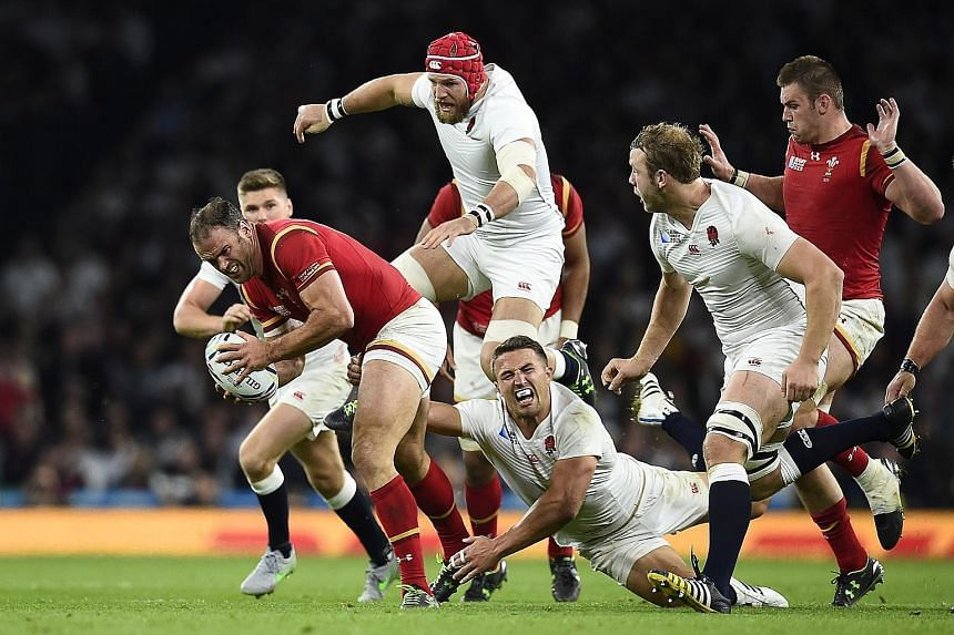Wales, with Jamie Roberts (with ball) held back by Sam Burgess, beat England 28-25. The hosts now need a victory against Australia.