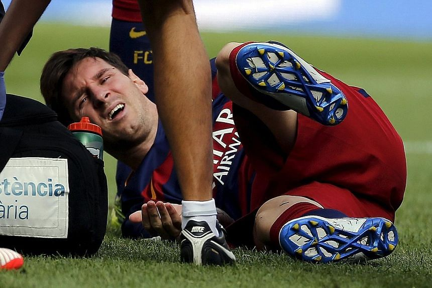 Barcelona star Lionel Messi in distress after hurting his left knee during the 2-1 win against Las Palmas. Barca later confirmed that the Argentinian had torn the internal collateral ligament of his knee and will be out for eight weeks.