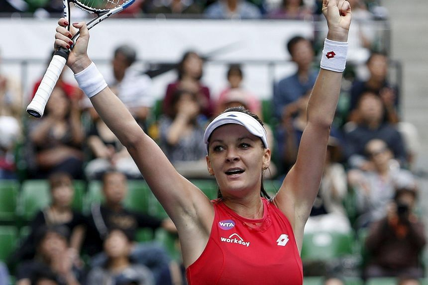 Agnieszka Radwanska celebrating after defeating Belinda Bencic in the Pan Pacific Open final in Tokyo yesterday. The Pole is climbing the rankings steadily after a lean first half of the year with a string of early exits.