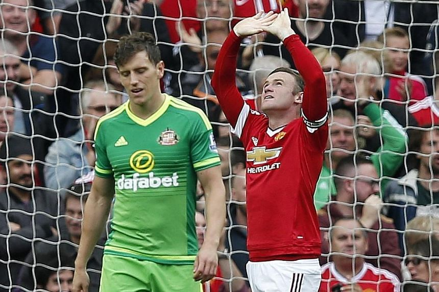 Manchester United captain Wayne Rooney celebrating after he ended an 11-game goal drought in the Premier League as he bundled in his 171st league goal for the club, drawing him level with Denis Law in third place on United's all-time list.