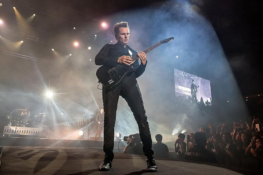 Muse frontman and guitarist Matt Bellamy (above) performed impressive guitar solos at last Saturday's concert.