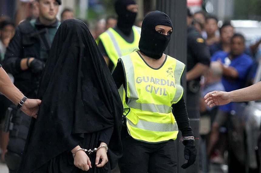 Spanish police in Gandia city arresting an 18-year-old Moroccan suspected of recruiting other women for ISIS via the Internet earlier this month.