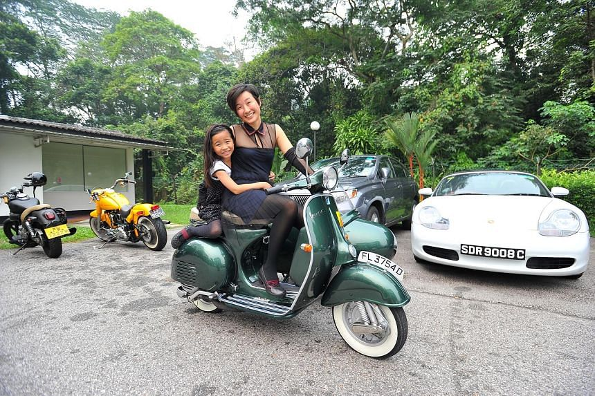 Ms Jobina Tan, 40, and her daughter Miriam, seven, at the start of the Distinguished Gentleman's Ride yesterday. The civil servant was among a handful of female riders who took part in the event, which is part of a global effort to raise money for pr