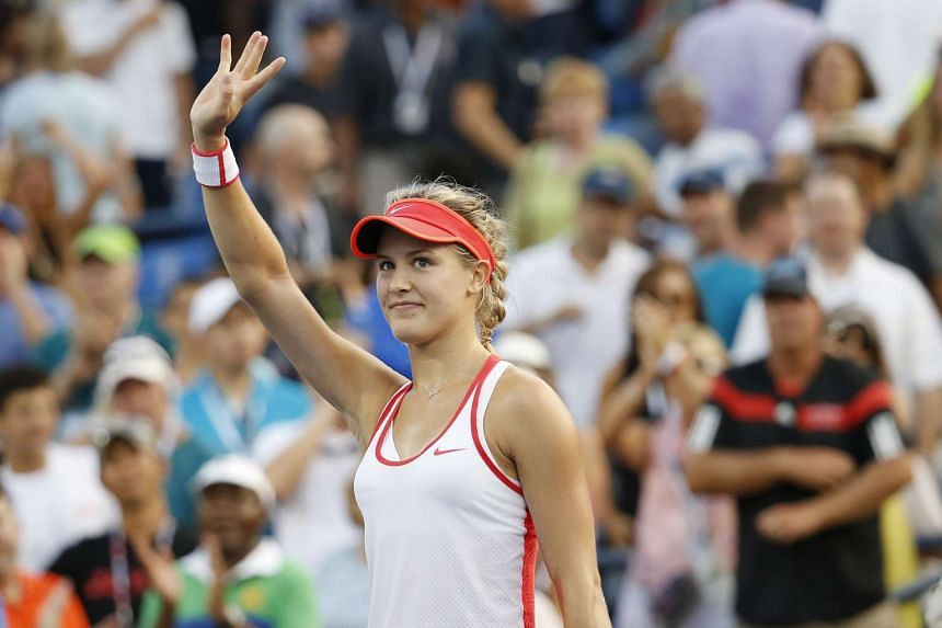 Eugenie Bouchard of Canada waves to the crowd after her match against Dominika Cibulkova of Slovakia on day five of the 2015 US Open tennis tournament.