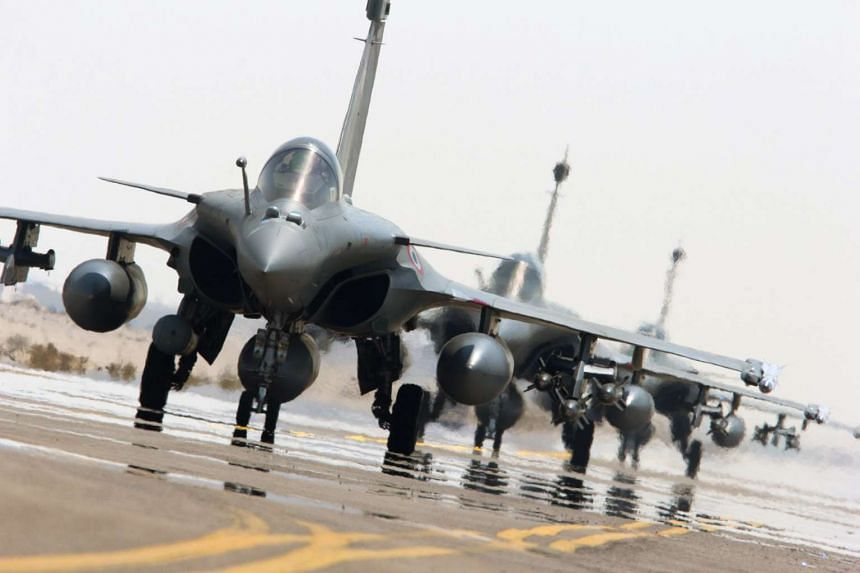 A handout picture provided by the Defense Audiovisual Communication and Production Unit (ECPAD) on Sept 27, 2015 shows Rafale fighter jets of the French army on the tarmac of a base in The Gulf.
