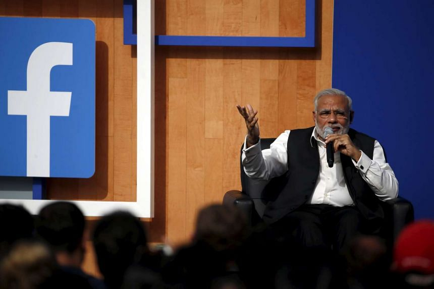 Indian Prime Minister Narendra Modi speaks on stage during a town hall at Facebook headquarters in Menlo Park, California on Sept 27, 2015.