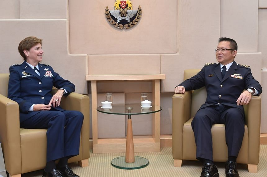 The Commander of the United States Pacific Air Forces, General Lori Robinson (left) has a dialogue with Singapore's Air Force Chief, Major-General Hoo Cher Mou.